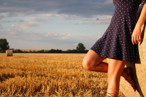 Legs in Polka Dot Dress in Field